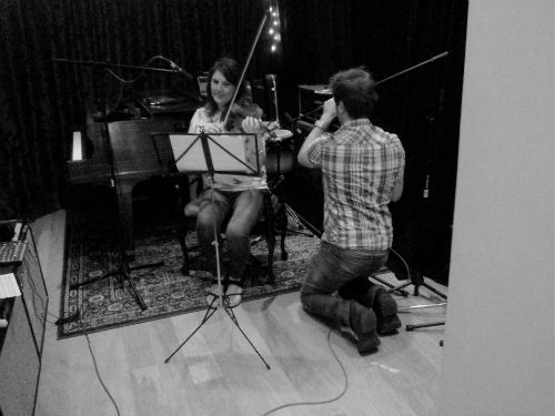 Caitriona plays parts from our film scoring portfolio recording session, Anthony adjusts the microphones to capture the perfect sound